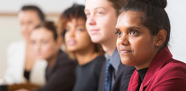 Young business people including an Australian aboriginal woman